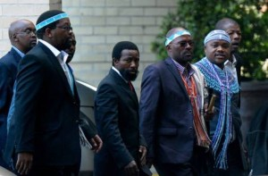 Thembu King Buyelekhaya Dalindyebo (C) flanked by chiefs, arrives on July 9, 2013 to visit former South African President Nelson Mandela at the hospital