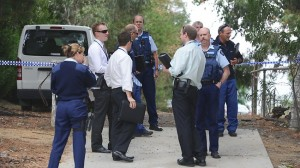 Investigators confer at the property in Endeavour Hills where body of Shao Qing 'Victor' Chen was found.