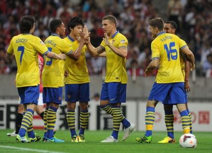 Podolski Celebrates With Teammates.