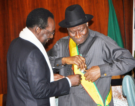 THE INTERIM PRESIDENT OF MALI, PROF. DIONCOUNDA TRAORE (L) CONFERRING THE HIGHEST HONOUR IN MALI  (GRAND-CROIX L'ORDRE NATIONALE DU MALI) TO PRESIDENT GOODLUCK JONATHAN IN ABUJA ON THURSDAY