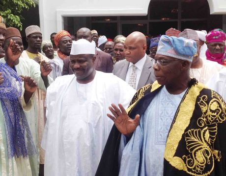 FORMER PRESIDENT OLUSEGUN OBASANJO (2ND-R), ACKNOWLEDGING CHEERS AT THE INAUGURATION OF ASARI WATER TREATMENT PLANT IN SOKOTO ON THURSDAY. WITH HIM ARE THE SPEAKER, HOUSE OF RERESENTATIVES, AMINU TAMBUWAL (L) AND GOV. ALIYU WAMAKKO OF SOKOTO (R).