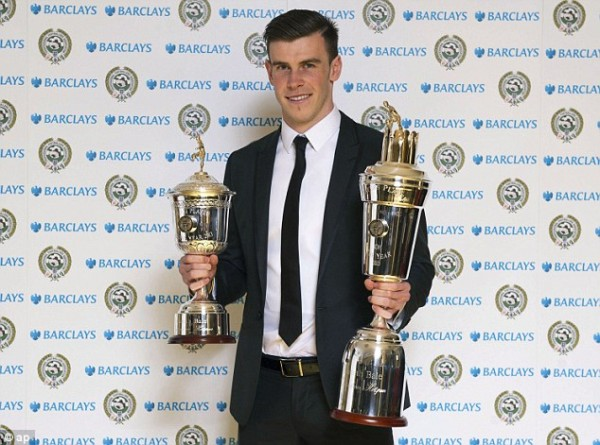 Wales Superstar Bale Shows Off His PFA Player and Young Player of the Year Gongs at Last Season's Award Ceremony.