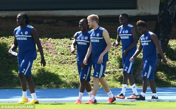 Moses Alongside Teammates at a Training Session.