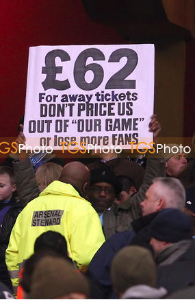 An Angry Arsenal Fan Protests Against The Heavy Ticket Price at the Emirate Last Season, Yet Nothing to Show as an Evidence.