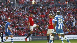 Robin van Persie Scores a Header to Hand United the Lead Against Wigan.
