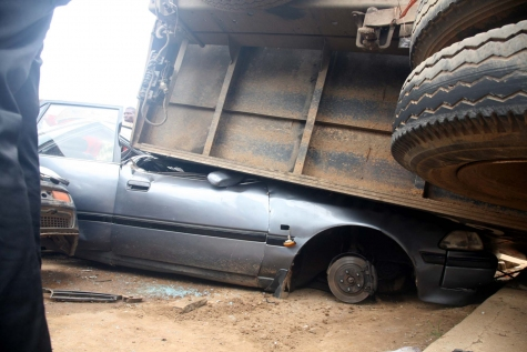 SORROWFUL TRAGEDY: Woman Killed, Many Injured As Truck Crushes Six Vehicles In Abuja (PHOTOS)