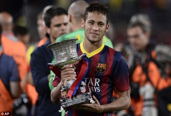 Neymar Lifts First Trophy With Barcelona.