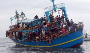 file: boat carrying migrants