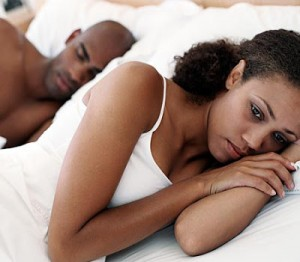 couple-in-bed-distressed-woman