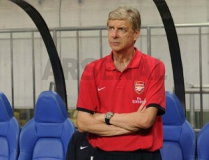 Arsene Wenger Watches His Side From the Dugout.