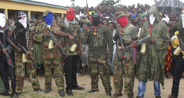KELVIN AND HIS GANG IN MILITARY CAMOUFLAGE, FITTED WITH HOODS AND MASKS, BRANDISHING HIGH CALIBER WEAPONS LAST WEEK ISSUED A 60-DAY ULTIMATUM FROM HIS BASE IN KOKORI, DELTA STATE, TO THE FEDERAL GOVERNMENT AND THREATENED TO WREAK HAVOC ON INNOCENT NIGERIAN CITIZENS.