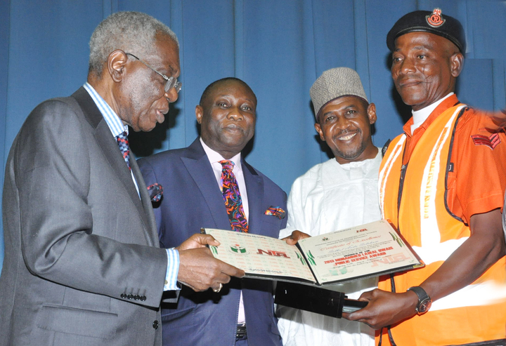 FROM LEFT: FORMER HEAD OF INTERIM  GOVERNMENT, CHIEF ERNEST SHONEKAN; DIRECTOR-GENERAL, NIGERIAN INSTITUTE OF ADVANCED LEGAL STUDIES (NIALS), PROF. EPIPHANY AZINGE; REPRESENTATIVE OF JUSTICE UWAIS, MR HARUNA UWAIS PRESENTING UWAIS PUBLIC SERVICE AWARD  TO SGT AUDU SELBOL DURING  NIALS LECTURE IN ABUJA ON WEDNESDAY