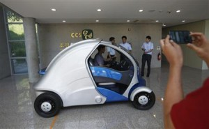 A visitor takes photographs of Armadillo-T at Korea Advanced Institute of Science and Technology in Daejeon