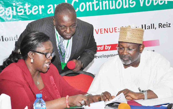 FROM LEFT: SECRETARY, INDEPENDENT NATIONAL ELECTORAL COMMISSION (INEC), MRS AUGUSTA OGAKWU; DIRECTOR, INTERNATIONAL COOPERATION AND PROTOCOL, MR OLUWOLE UZZI AND CHAIRMAN, INEC, PROF. ATTAHIRU JEGA, AT THE  EXPERIENCE-SHARING AND CONFIDENCE BUILDING CONFERENCE ON THE VOTER REGISTER AND CONTINUOUS VOTER REGISTRATION IN ABUJA