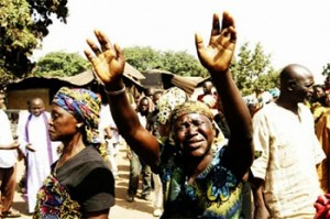 file: women mourning deaths of victims of an attack in Kaduna