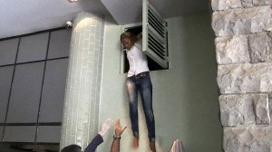 An image grab taken from AFP TV shows a Kenyan woman coming out of an air vent where she was hiding during the attack.  Picture: AFP