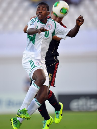 Getty Image: Kelechi Iheanacho Jumps for the Ball During Eaglets' Drubbing of Mexico in Al Ain on Saturday.