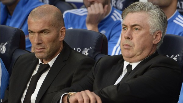 AFP Image: Carlo Ancelotti and Zinidane Zidine Watches El Clasico From the Dugout.