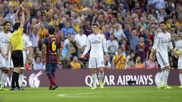 Image AFP: Gareth Bale Being Showed a Yellow Card During Saturday's El Clasico.