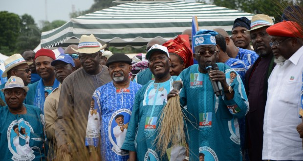 PART OF THE CROWD AT THE ALL PROGRESSIVES CONGRESS (APC) ANAMBRA STATE CANDIDATE DR. CHRIS NGIGE'S CAMPAIGN LAUNCH IN ONITSHA...YESTERDAY. LEFT: APC LEADER ASIWAJU BOLA AHMED TINUBU SPEAKING AT THE RALLY... YESTERDAY. WITH HIM (FROM RIGHT) ARE: CHIEF TOM IKIMI, IMO STATE GOVERNOR ROCHAS OKOROCHA, SECRETARY TO THE GOVERNMENT OF THE STATE OF OSUN ALHAJI MOSHOOD ADEOTI, APC INTERIM NATIONAL CHAIRMAN CHIEF BISI AKANDE, NGIGE, EKITI STATE GOVERNOR DR. KAYODE FAYEMI, EDO STATE GOVERNOR ADAMS OSHIOMHOLE, DR. OGBONNAYA ONU AND OTHERS (PHOTO CREDIT: THE NATION)