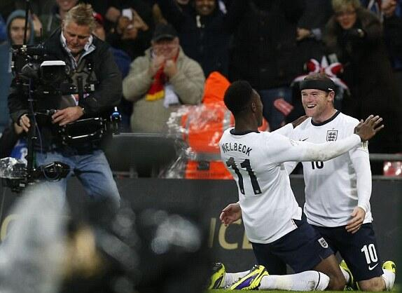 Rooney and Welbeck After the Former Poked in the Latter's Rebounded Effort in Wembley.