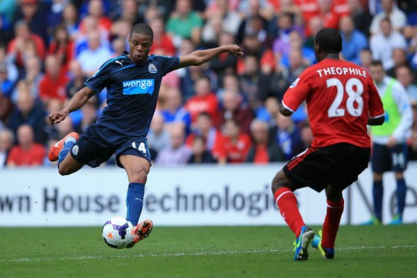 Loic Remy Drives a Shot Past Kevin Theophile-Catherine of Cardiff Into the Net.