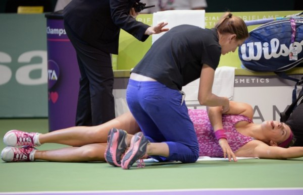 Azarenka Being Attended By a WTA Official to After Hurting Herself.