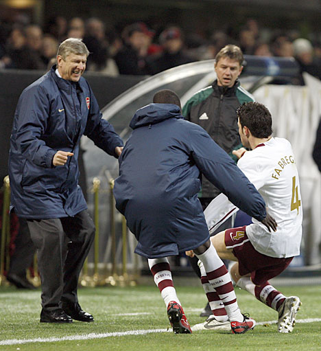 Fabregas Celebrates a Champions League Goal With His Former Manager Wenger.