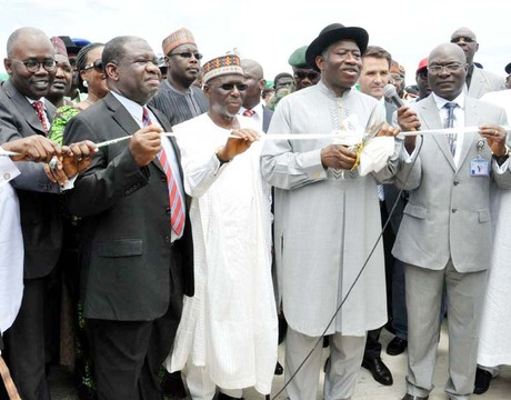PRESIDENT GOODLUCK JONATHAN (5TH-L), CUTTING THE TAPE TO INAUGURATE THE GEREGU II POWER STATION IN KOGI ON THURSDAY (3/10/13). FROM LEFT: GOV. GABRIEL SUSWAM OF BENUE; MINISTER OF JUSTICE, MOHAMMED ADOKE (SAN); MINISTER OF POWER, PROF. CHINEDU NEBO; GOV. IDRIS WADA OF KOGI AND CHAIRMAN, SENATE COMMITTEE ON POWER, SEN. PHILIP ADUDA.