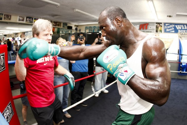 Kayode and His Trainer Freddie Roach Preparing for a Fight.