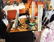 VICE-PRESIDENT NAMADI SAMBO (R), ENROLING FOR THE NATIONAL IDENTITIFICATION NUMBER (NIM) AT THE PRESIDENTIAL VILLA IN ABUJA ON THURSDAY