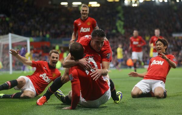 United Players Celebrates After Robin van Persie Winner Against Arsenal.