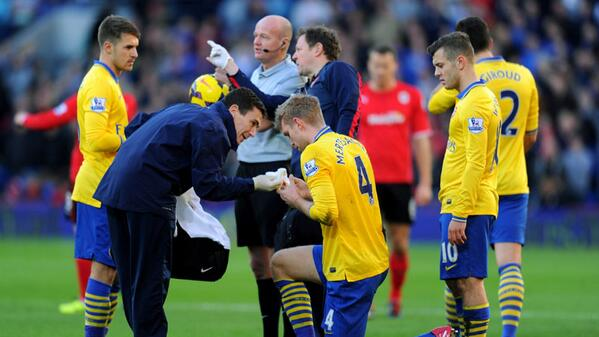 Mertesacker Receives Treatment After Clashing With Sagna.