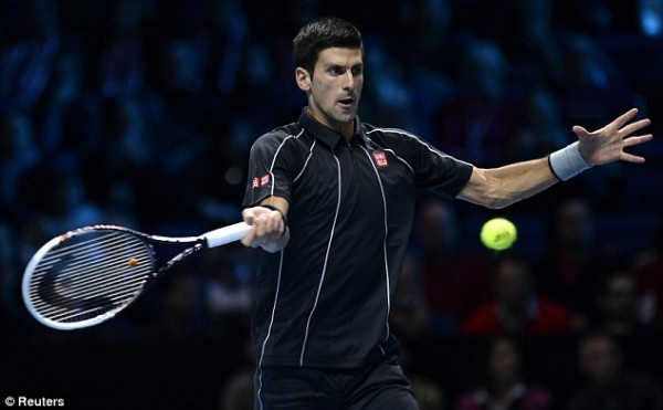 Image Credit: Reuters. Djokovic Hits Forehand on His Way to a 6-3, 6-3 Victory Over Wawrinka.