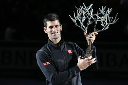 Reuters: Novak Djokovic Holds His Second Paris Masters Trophy at the Palais Omnisports de Paris, Bercy.