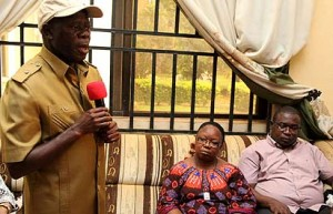 From left: Governor Adams Oshiomhole of Edo State; Mrs. Grace Iyayi, (widow) and Mr Oriabure Iyayi, (son), during a condolence visit, yesterday, by the governor