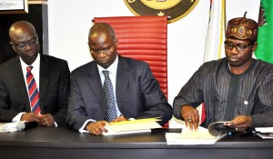 file photo: Fashola signing the Land Use Act
