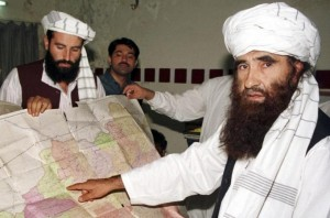 Nasiruddin Haqqani , left, and his father Jalaluddin, right [Reuters]