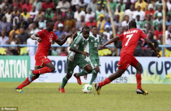 Victor Moses Dribbles Flames of Malawi Players in Calabar.