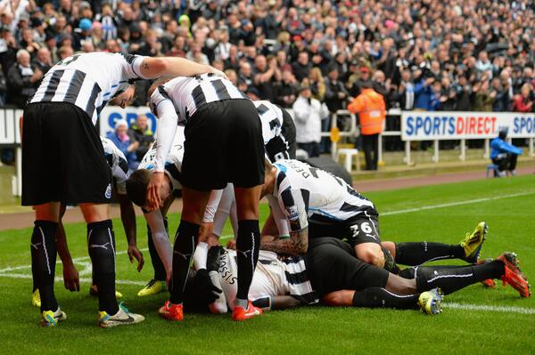 Yoan Gouffran is Mobbed By Teammates After Scoring the Opening Goal.