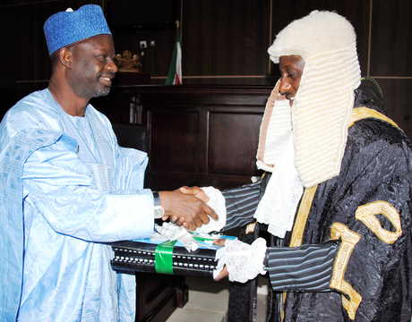 GOV. IBRAHIM DANKWAMBO (L), PRESENTING THE 2014 APPROPRIATION BILL (BUDGET) TO THE SPEAKER OF THE STATE HOUSE OF ASSEMBLY, ALHAJI INUWA GARBA, IN GOMBE LAST FRIDAY (27/12/13).
