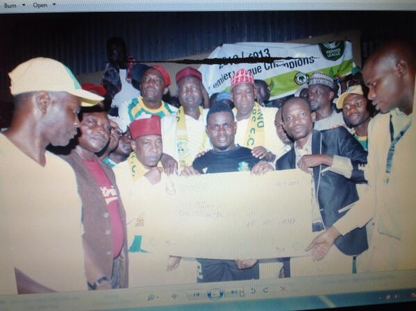 Image Credit: LMC. Pillars Receives the N10m Cheque for Winning the 2013 Glo Premier League.