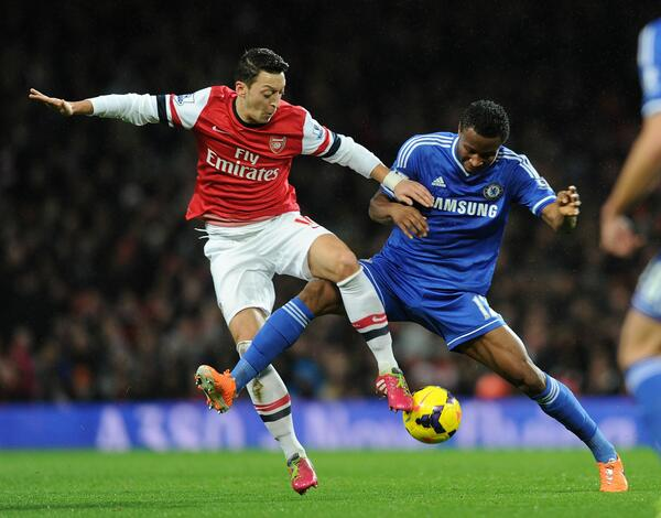 The Midfield's Mine: John Mikel Tackles Mesut Ozil During Monday Night Derby.