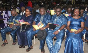 Iyayi's widow and children at the funeral service