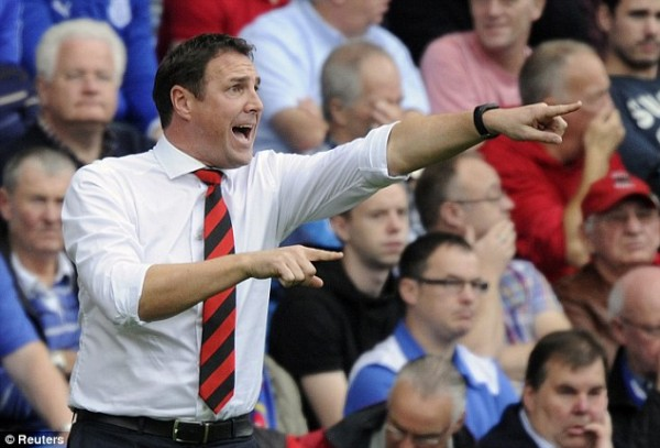 Cardiff City Sacks Mackay.