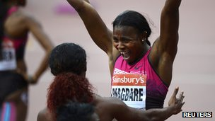 Okagbare Celebrates With Fraser-Pryce After Winning the 100m at the Sainsbury's Anniversary Games.