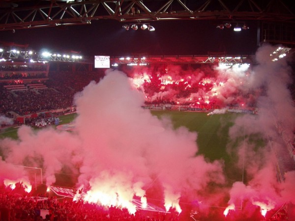 Olympiakos Supporters Lit Flares During their Group Game Against Anderlecht on December 10.