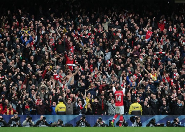 Walcott Celebrates His Goal in Front of Arsenal Fans.