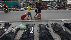 Locals cover their noses from the stench of the dead in Tacloban.