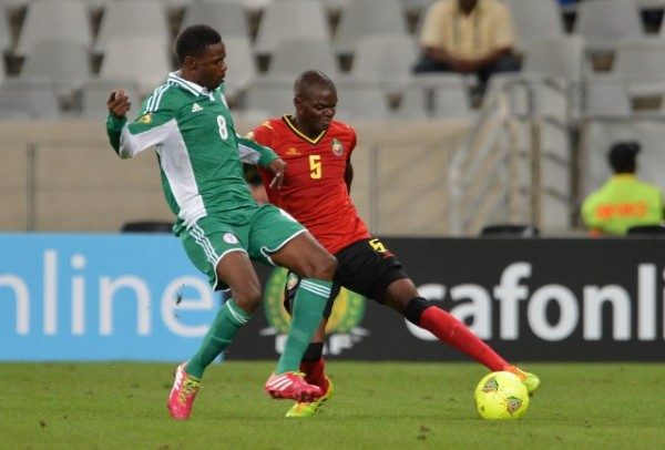 Rabiu Ali Struggles for the Ball Against a Mozambican Opponent.